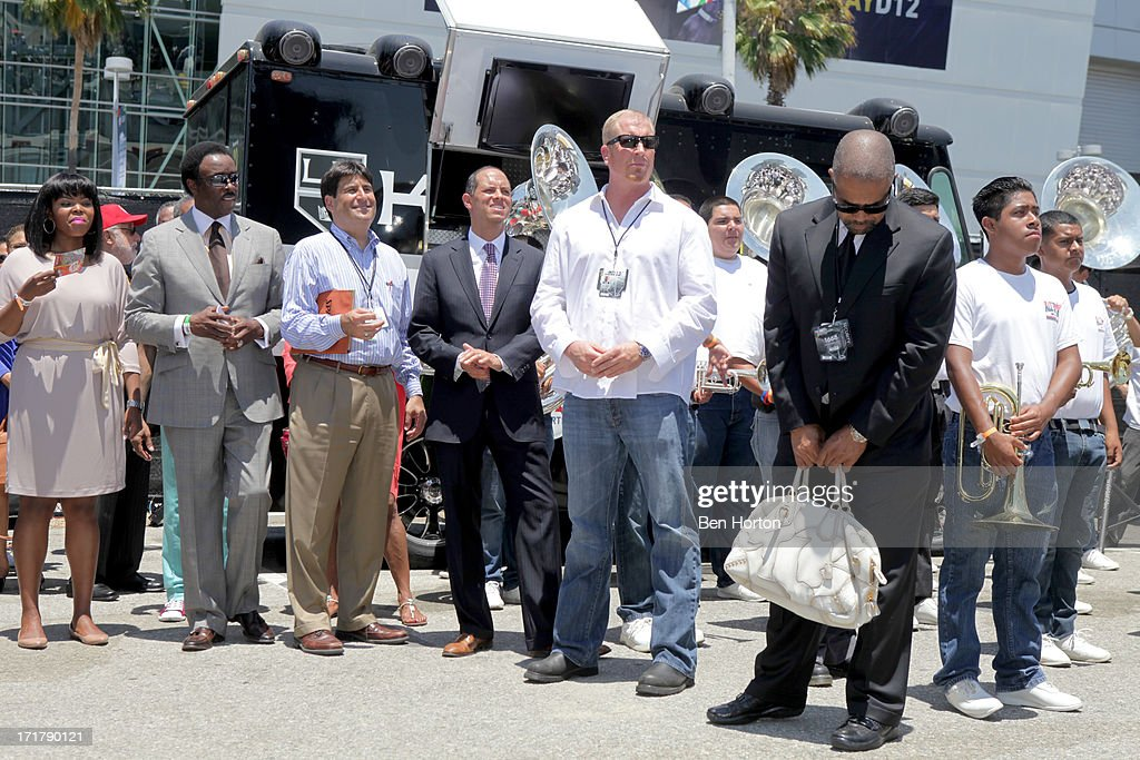 Compton Mayor Aja Brown KABC news anchor Jim Hill and Chief Legal and Development Officer at AEG Ted Fikre attend the Fan Fest Outdoor during the...