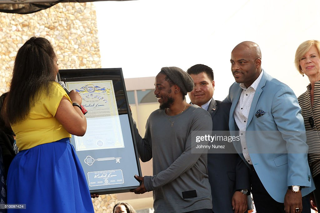 Compton Mayor Aja L. Brown (L), Senator Isadore Hall III (2nd r), and U.S. Representative Janice Hahn (r) present recording artist <a gi-track='captionPersonalityLinkClicked' href=/galleries/search?phrase=Kendrick+Lamar&family=editorial&specificpeople=8012417 ng-click='$event.stopPropagation()'>Kendrick Lamar</a> (c) with the Key To The City on February 13, 2016, in Compton, California.