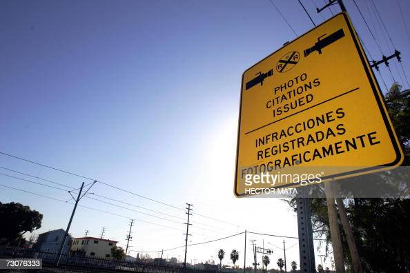 A sign warning drivers of the presence of cameras is displayed in Compton CA 22 January 2007 where Los Angeles Sheriff Lee Baca announced the results...