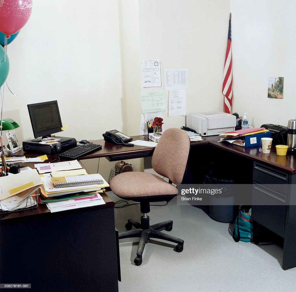 Computer and desk in empty office : Stock Photo