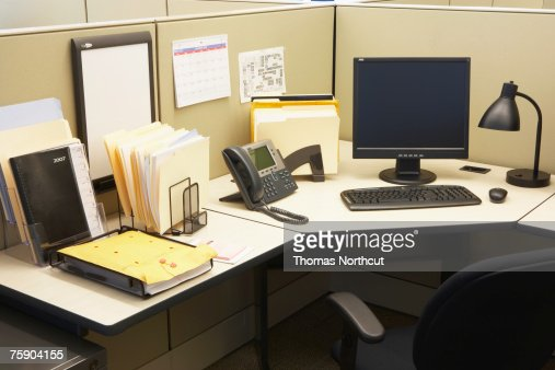 Computer and landline phone in office, elevated view