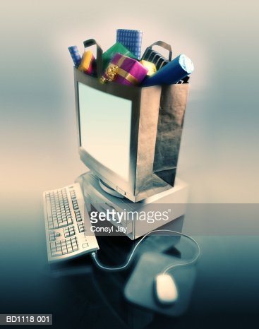 Computer, bag filled with gifts representing monitor (Composite) : Foto de stock