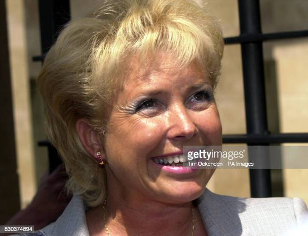 Computer consultant Margaret Moore smiles after she was awarded a symbolic one franc in damages at the court of Appeal in AixenProvence after the...