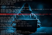 Hacker using laptop. Lots of digits on the computer screen.