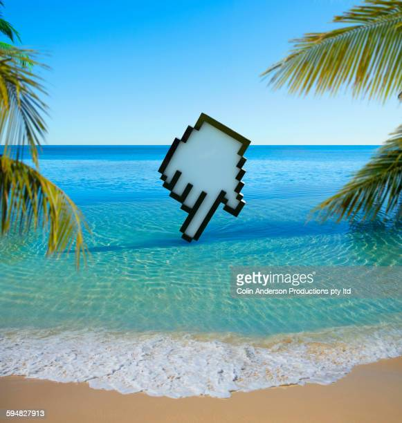 Computer cursor clicking on tropical beach
