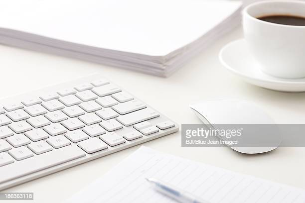 Computer, files and coffee on office desk