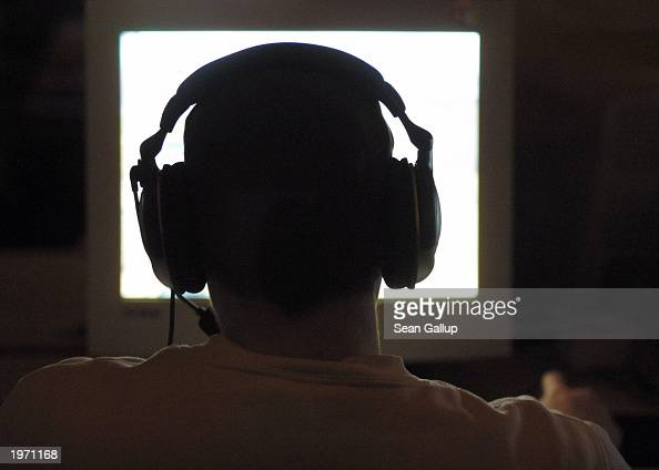 A computer game enthusiast plays a computer game during a computer gaming summit May 3 2003 in Osnabrueck Germany About 900 computer gamers from...
