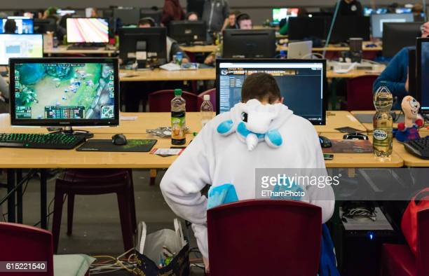 Computer game player at LAN party /cosplay computer game tournament