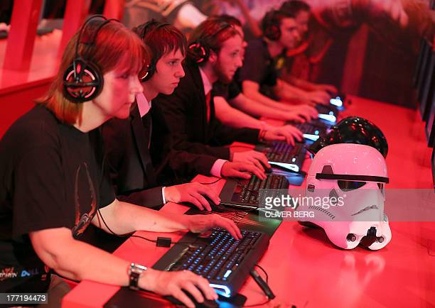 Computer games enthusiasts play during the gamescom fair in Cologne western Germany on August 22 2013 The trade fair for interactive games and...
