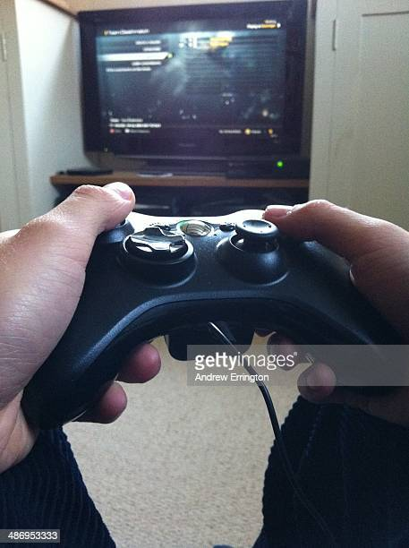 Computer Gaming using TV and hand held controller unit