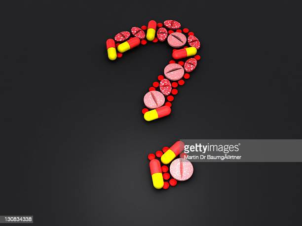 Computer graphics, 3d-render of pharmaceuticals, capsules, pills, tablets, form a question mark