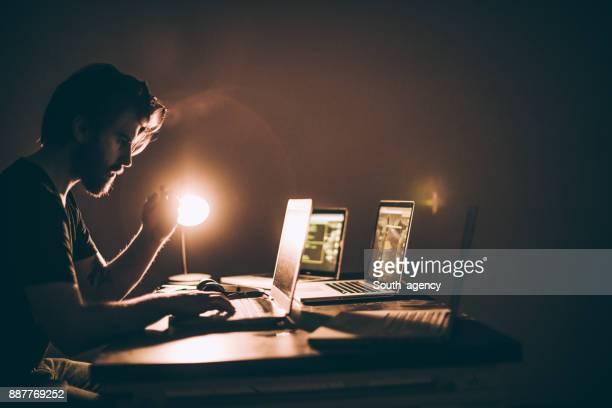 Computer hacker in dark room
