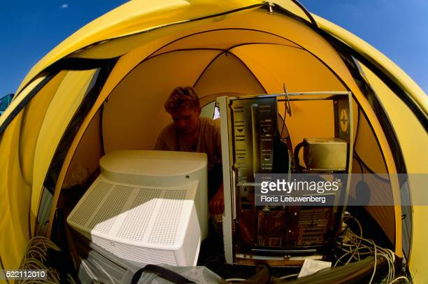 Computer Hacker in Tent in the Netherlands