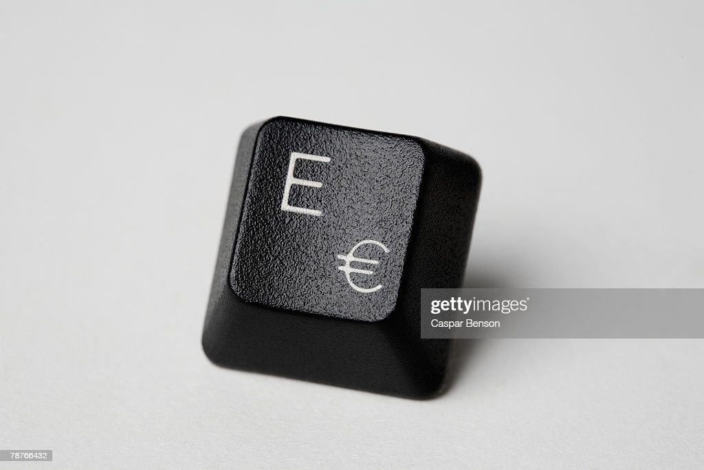 A computer key with the letter E and the Euro symbol