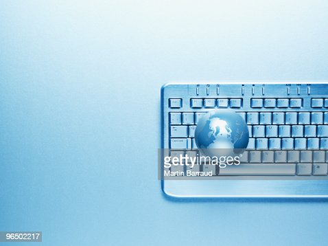 Computer keyboard and globe : Stock Photo