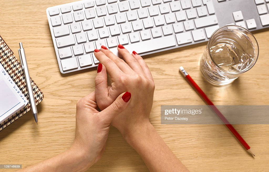Computer keyboard and repetitive strain injury : Stock Photo