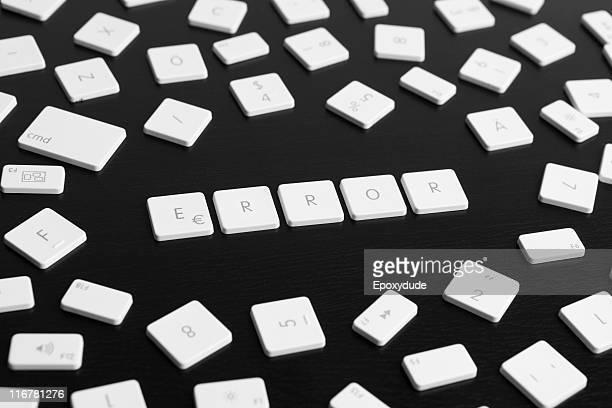 Computer keys spelling the word ERROR