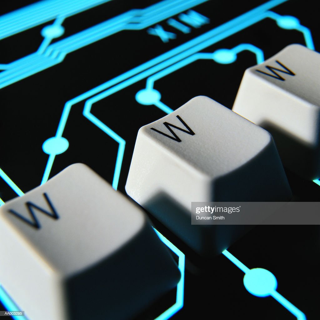 WWW Computer Keys Superimposed on Circuitry : Stock Photo