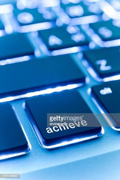 Computer laptop keypad 'achieve' button.