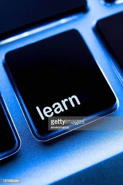 Computer laptop keypad 'learn' button.