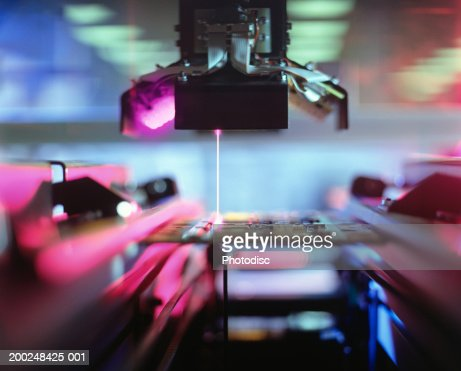 Computer machinery with laser : Stock Photo