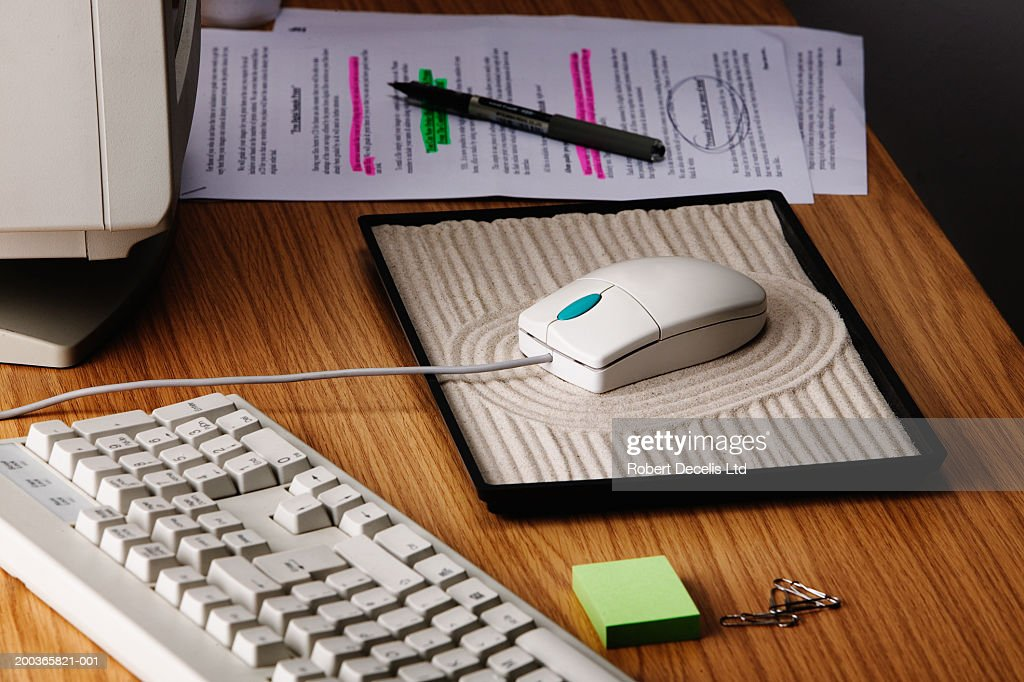 Computer Mouse On Zen Garden, Close Up Of Desk : Stock Photo