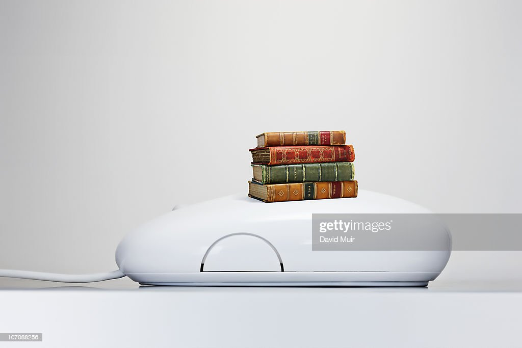 computer mouse with books  : Stock Photo