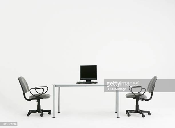 Computer on desk and chairs