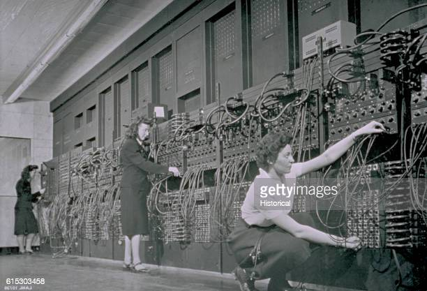 Computer operators program ENIAC the first electronic digital computer by plugging and unplugging cables and adjusting switches | Location...