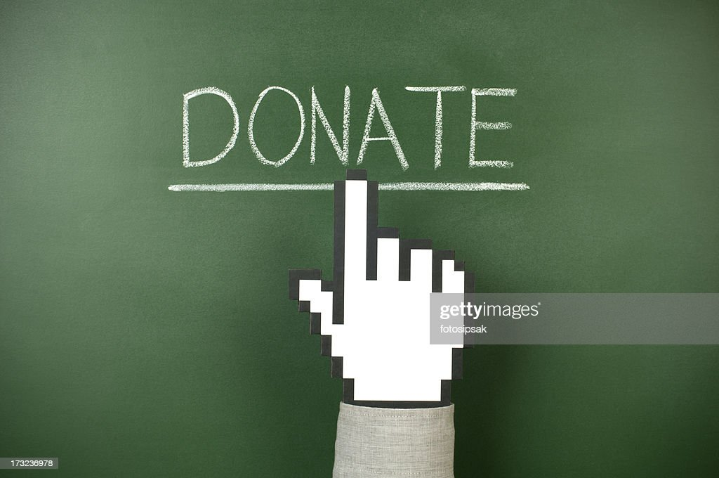 Computer pointer hand pointing to written word DONATE