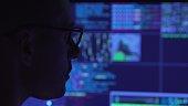 Computer programmer in darkness. 4K
