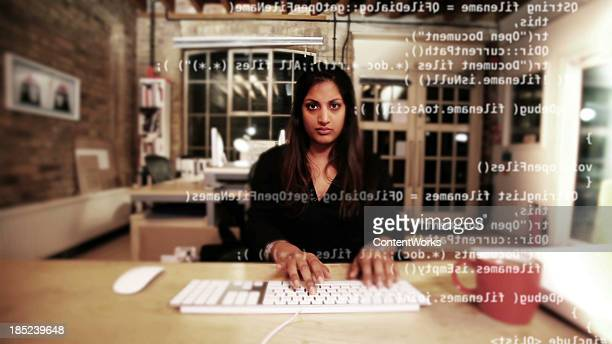 Computer programmer typing code