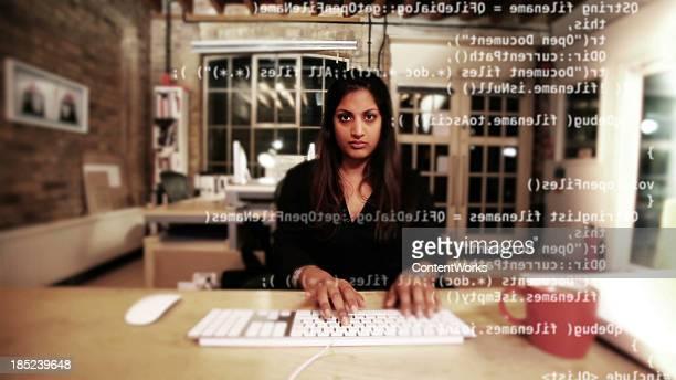 Computer programmer typing code