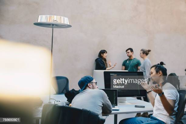 Computer programmers discussing plan in creative office