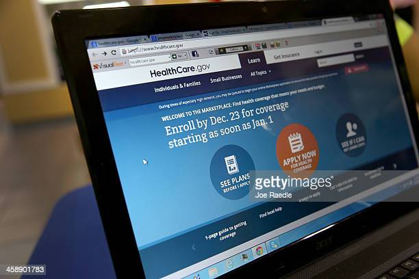 A computer screen reads 'Enroll by Dec 23 for coverage starting as soon as Jan 1' as agents from Sunshine Life and Health Advisors help people...