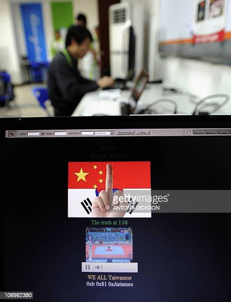 A computer screen shows the hacked Asian Taekwondo Union's website as a journalist works in the background during the Taekwondo matches at the...