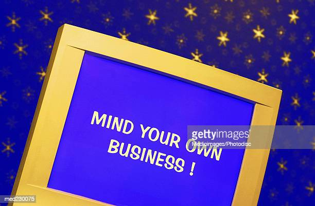 A computer screen with the words mind your own business