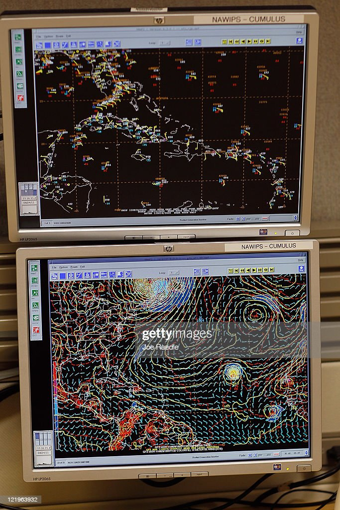 Computer screens are seen as specialists track Hurricane Irene at the National Hurricane Center on August 24, 2011 in Miami, Florida. Irene is on track to move over the Bahamas as a category 3 storm and from there cooler ocean temperatures are expected to lessen the wind speeds, but it could still be a major storm as it approaches the North Carolina coast August 27.