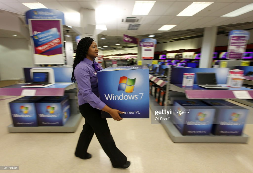 A computer store employee carries promotional signage for Microsoft's new operating system 'Windows 7' ahead of its official launch at midnight tonight on October 21, 2009 in London, England. Microsoft's much-anticipated version of its Windows operating system for PCs aims to eradicate many of the problems associated with its predecessor 'Vista'.