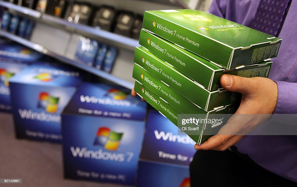 A computer store employee stacks copies of Microsoft's new operating system 'Windows 7' ahead of its official launch at midnight tonight on October 21, 2009 in London, England. Microsoft's much-anticipated version of its Windows operating system for PCs aims to eradicate many of the problems associated with its predecessor 'Vista'.