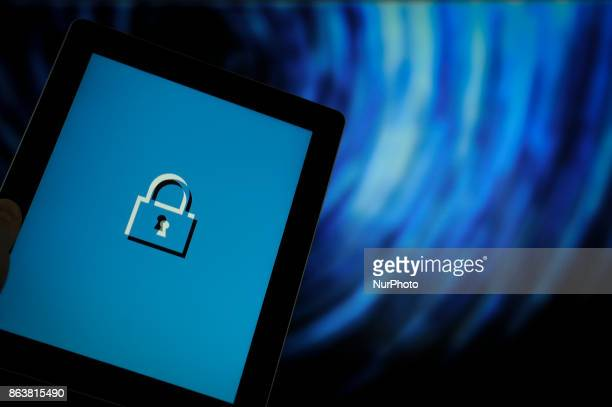 A computer tablet with a security lock symbol is seen in this photo illustration on October 20 2017
