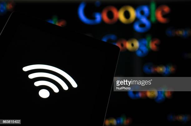 A computer tablet with a WiFi symbol with Google logos in the background is seen in this photo illustration on October 20 2017