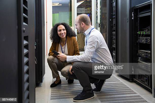 Computer technician in server room