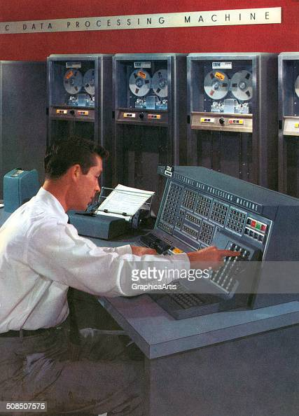 A computer technician operates a computer console in a room filled with early computers IBM's Electronic Data Processing Machine 1950s Screen print...