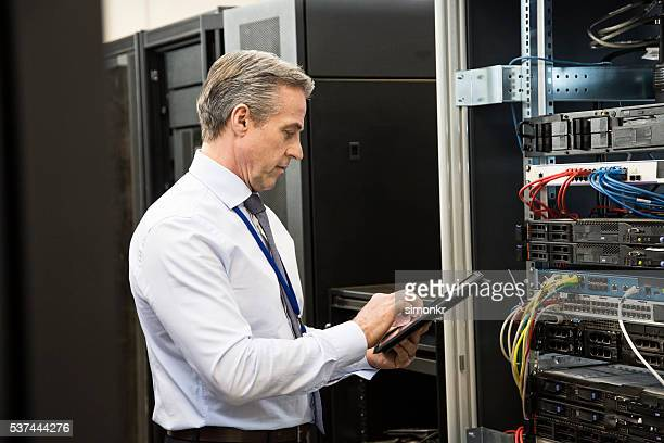 Computer technician using tablet
