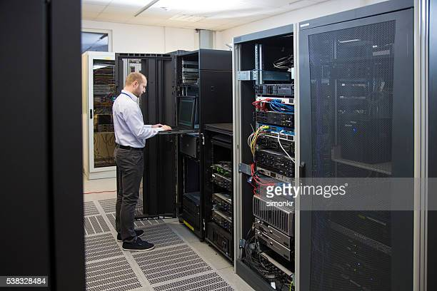 Computer technician working on laptop