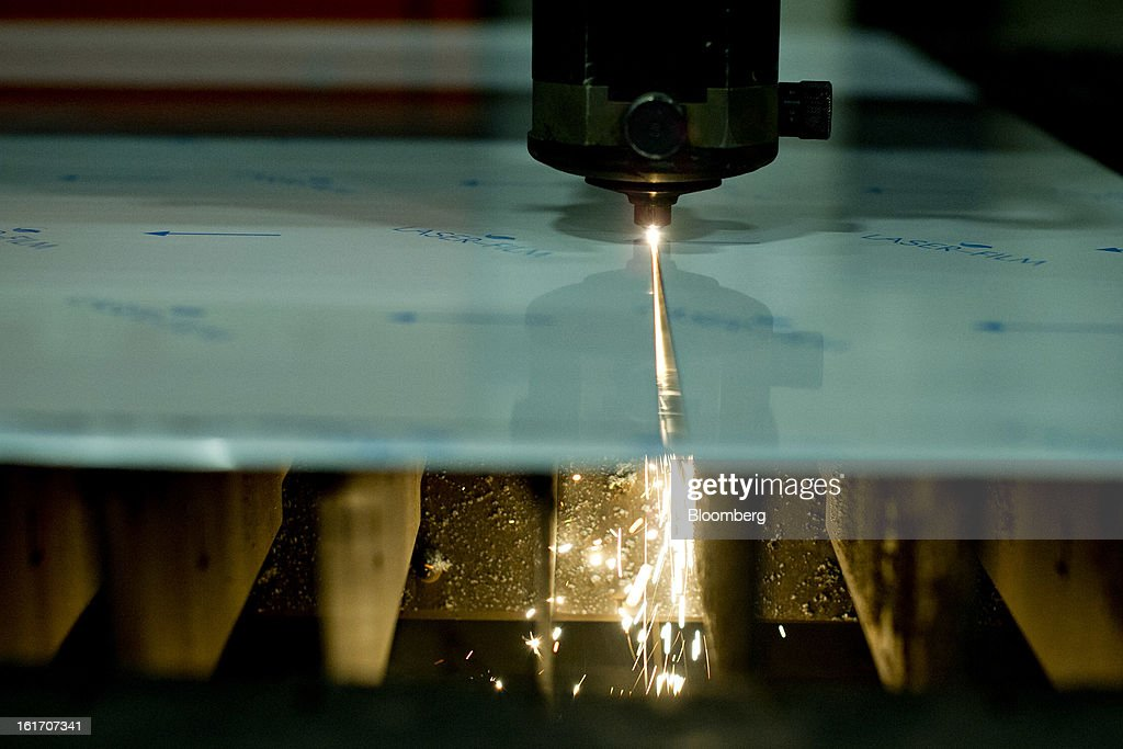 A computer-controlled laser cutting head makes a cut in a stainless-steel panel at the Giese Manufacturing Co. in Dubuque, Iowa, U.S., on Thursday, Feb. 14, 2013. The U.S. Federal Reserve is schedule to release industrial productions figures on Feb. 15. Photographer: Daniel Acker/Bloomberg via Getty Images