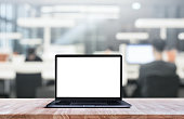Modern computer,laptop with blank screen on blur library,working space background