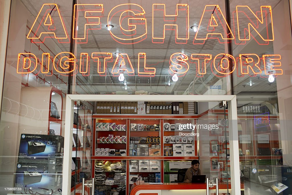 Computers and accessories are displayed for sale at Afghan Digital Store inside a shopping center for electronic goods in Kabul, Afghanistan, Wednesday, Aug. 7, 2013. A smooth U.S. exit from Afghanistan will depend on Pakistans cooperation with the logistical pullout, as well as its backing for peace talks in neighboring Afghanistan and an end to any support for extremist proxies operating there. Photographer: Victor J. Blue/Bloomberg via Getty Images
