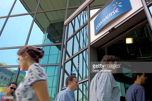 Comverse workers pass under the company logo at the entrance to Comverse''s headquarters July 12 2001 in Tel Aviv Israel Comverse the world''s...